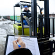 Стоковое фото: Forklift at entrance to modern warehouse