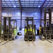 Foto Stock: Forklifts in warehouse