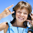 Happy little girl in headphones — Stock Photo