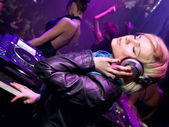 DJ girl in the nightclub — Stock Photo