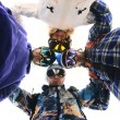 Stock Photo: Snowboarders in circle looking down