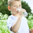Child drinking pure water — Foto de Stock