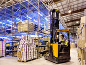Worker on forklift — Stockfoto