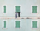 Clothes hanging outside window — Stock Photo