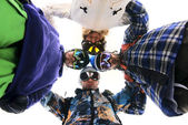 Snowboarders in circle looking down — Stock Photo