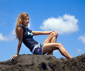 Beautiful woman on the rock — Stock Photo
