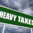 Heavy taxes sign — 图库照片