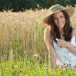 Young and happy girl with an hay hat — Stock Photo #11668000