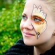 Stock Photo: Young womwith face painting