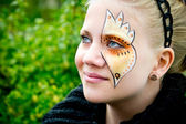 Young woman with face painting — Stock Photo