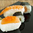 Sushi set on black background — Stock Photo #11122190