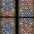 Stained-glass window in Catholic temple - Stock Photo