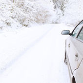 Car on snowy winter road — Stock Photo