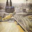 Cologne cityscape with Rhine river and famous cathedral. Vintage City in Germany. - Stock Photo