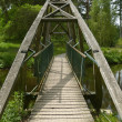 Wooden footbridge — Stock Photo
