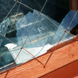 Window frame with  broken glass - Foto Stock