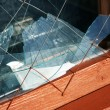 Window frame with  broken glass - Photo