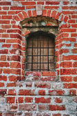 Window lattice to brick wall — Stock Photo