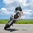 Trick on motorcycle - Stockfoto