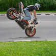 Trick on motorcycle — Stock Photo