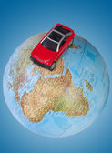 Car on globe — Stock Photo