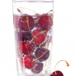 Sweet cherry in glass with water — Stock Photo