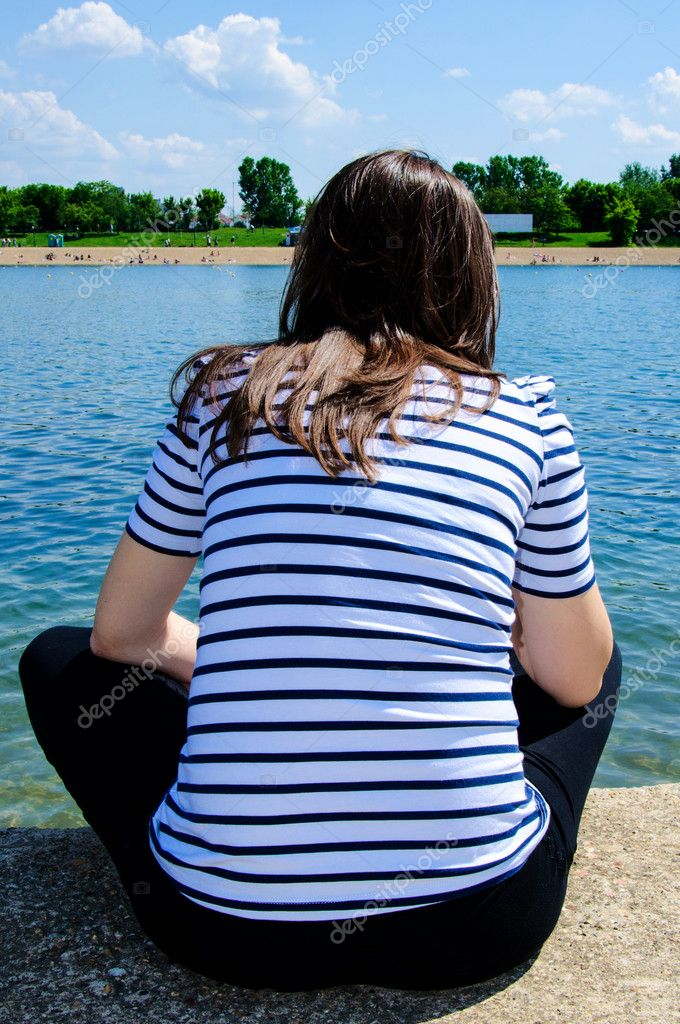Young woman siting alone — Stock Photo #10998685