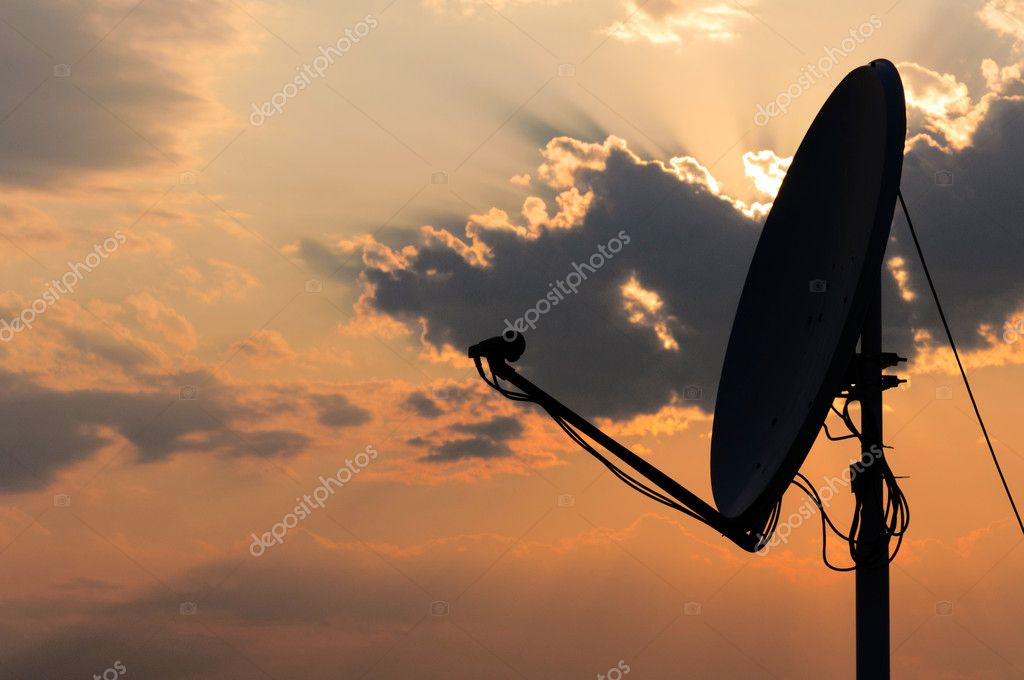 Satellite dish in contra light  Stock Photo #11599800