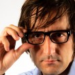 Man holding eyeglass — Stock Photo