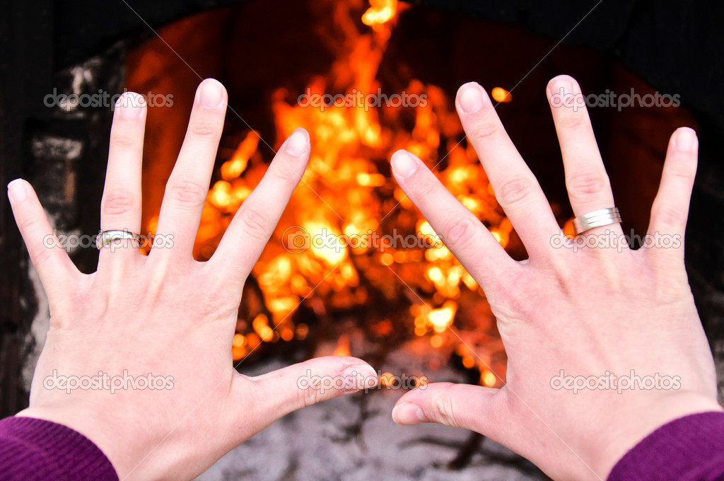Hands on the fire — Stock Photo #11954592