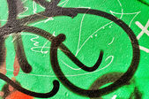 Green metal with graffiti — ストック写真