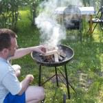 Man preparing barbecue — Stock Photo