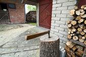 Axe and barn — Stock Photo