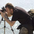 Stock Photo: Photographer at work