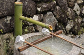 Fresh water in japanese well — Stock Photo