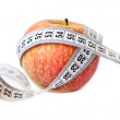 Red apple and measuring tape — Stock Photo #11796546