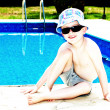 Little boy applying sun cream whilst sunbathing — Stock Photo
