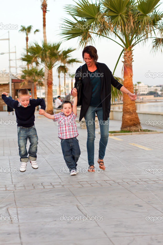 Mum and two sons walking on holiday — Stock Photo #10961880