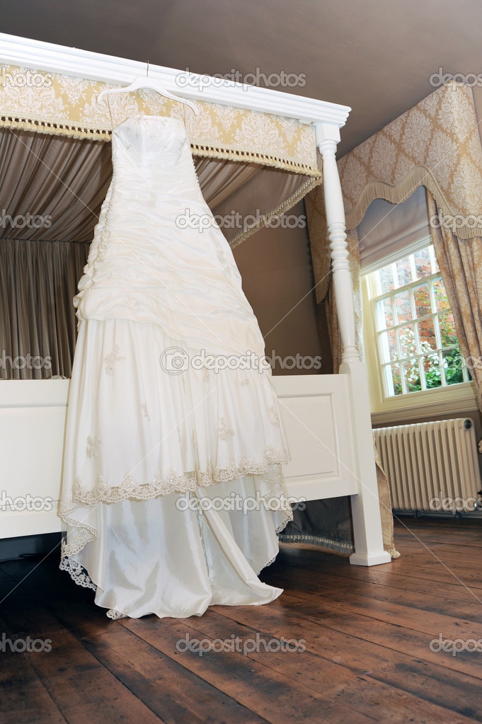 Wedding dress hanging in reception room  Stock Photo #11058658
