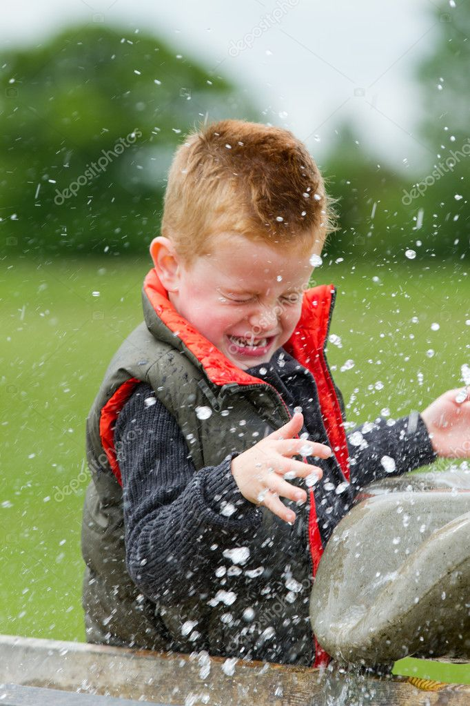 A young boy having fun in the countryside — Stock Photo #11252971