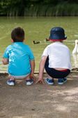 Boys at duck pond — Stock Photo