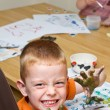 Little boy painting a picture — Stock Photo