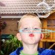 Boy blowing bubbles — Stock Photo #11749718