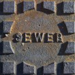 Old Sewer Plate - Stock Photo