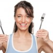 Woman with fork and knife — Stock Photo