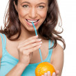 Woman with straw and orange — Stock Photo