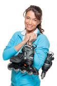 Woman with skates — Stock Photo