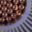 Little golden Metallic Magnetic balls in radiator — Stock Photo