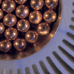 Little golden Metallic Magnetic balls in radiator — Stock Photo #11373042