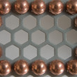 Stock Photo: Little balls in metallic honeycomb pattern